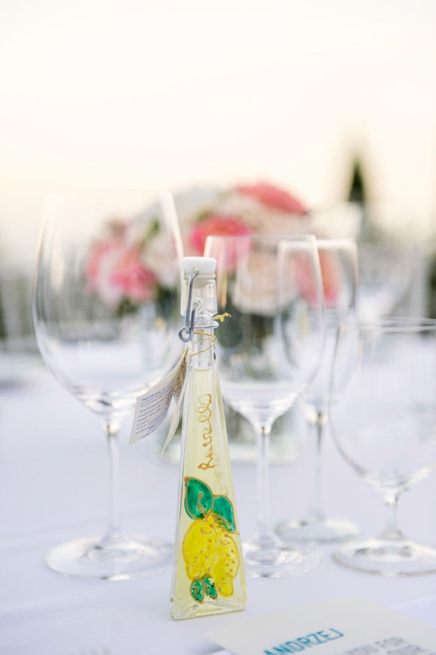 <strong>On wedding favours for guests:</strong> <br><br> We gave each guest a personalised keepsake bottle of limoncello which had our wedding date and names engraved on it.