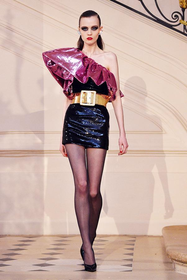 <strong>SAINT LAURENT COUTURE</strong><BR><BR> The glamour of rock n' roll (rather then the grungy side), was Slimane's MO today in Paris, along with a heavy '80s-influence. Mini skirts and sharp shoulders paraded the catwalk, and most looks were finished off with a wide belt cinched at the waist.