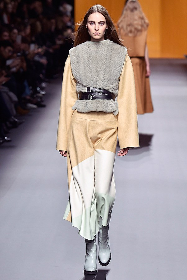 <strong>HERMÈS</strong><BR><BR> Autumn winter 2016 marks Nadege Vanhee-Cybulski's third main collection for Hermès, and it's evident that the designer is coming into her own. This season, Cybulski played with far more experimental looks such as a belted shearling vest and brown sweater layered over a neon green turtleneck, and added prints into the mix.