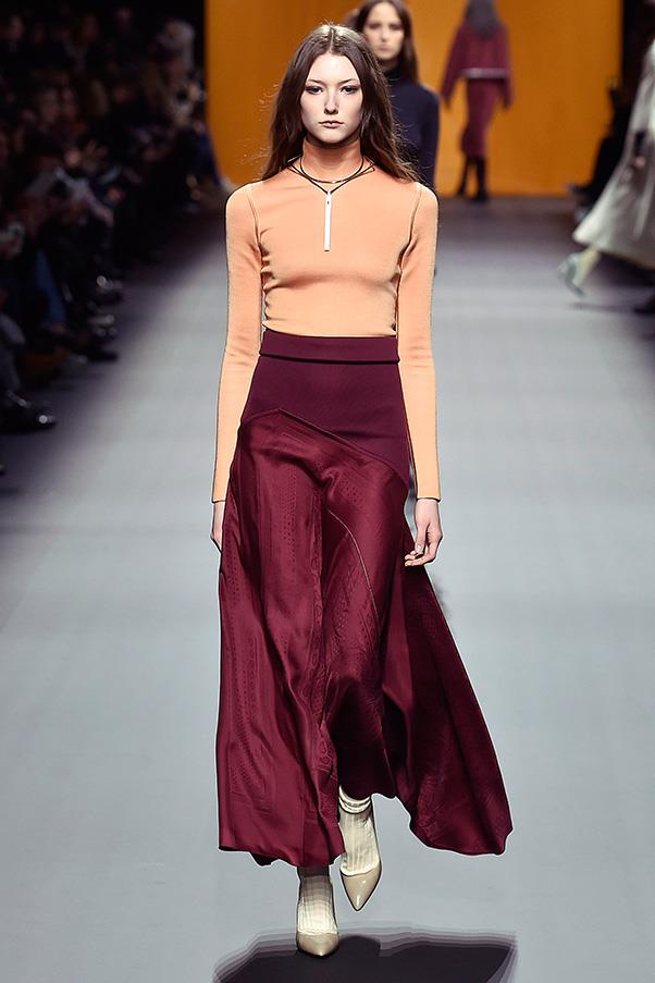 <strong>HERMÈS</strong><BR><BR> For the final looks, Cybulski played with silhouette, pairing languid silk skirts with sweaters or creating entire sweater dresses. She also continued experimenting, combining thin socks with heels.