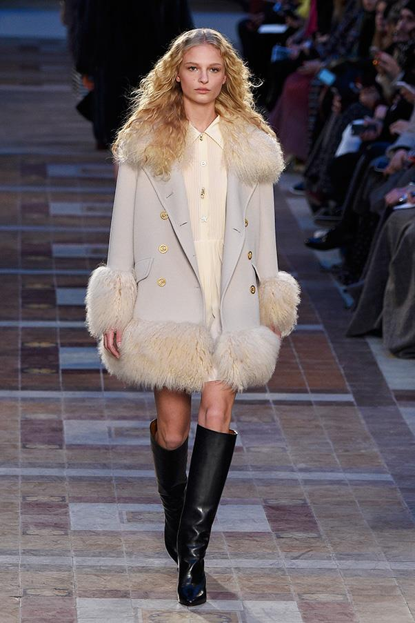 <strong>SONIA RYKIEL</strong><BR><BR> Shoes ranged from furry sandals and clogs to knee high boots—and outerwear was key. A mid-length cream peacoat with fur embellishment was a standout. Layered over a silk shirt dress, it was unfussy and easy. Elsewhere, bags were big, furry and boxy, small and hand-held or strewn around the waist.