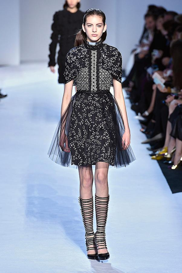 <strong>GIAMBATTISTA VALLI</strong><BR><BR> Valli's autumn winter offering veered on the darker side; prints in black and dark purple, with the occasional spattering of white tulle dresses and a dash of yellow. His woman remained playful, but more grown up, perhaps with a of whiff of seriousness.
