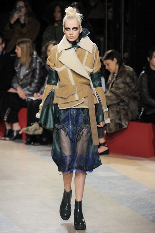 <strong>SACAI</strong><BR><BR> For autumn winter, Abe explored some new ideas, like bondage belts below the hips and around the legs and waist. She melded a sheer dress and shearling in a way that made you think, 'why didn't I think of that?'