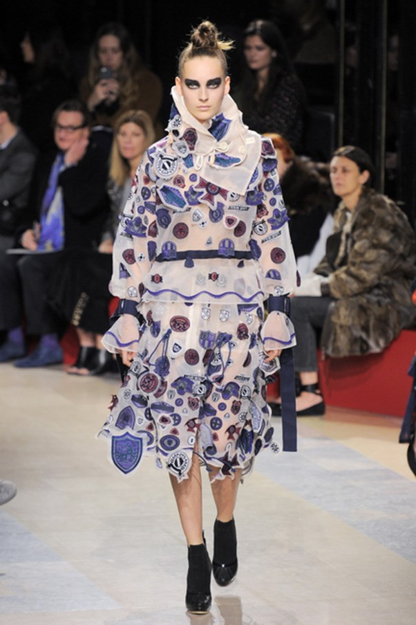 <strong>SACAI</strong><BR><BR> The final looks were about chiffon dresses and skirts stamped with emblems and patches—like a boarding school dress gone mad. If looking like a cool, confused school girl with attitude is wrong, we don't want to be right. —<em>Kerry Pieri</em>