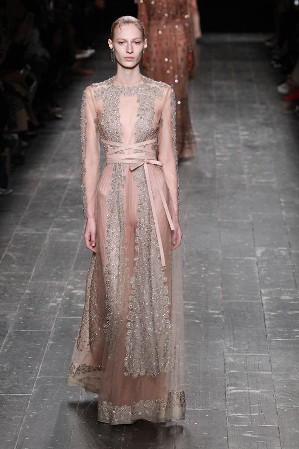 <strong>VALENTINO</strong><BR><BR> The show moved on into lighter territory, with black opening up into nude, tribal-printed dresses and skirts. There was a strong ballet influence throughout the show, with nude flats and lace-up heels, and sparkly stockings.