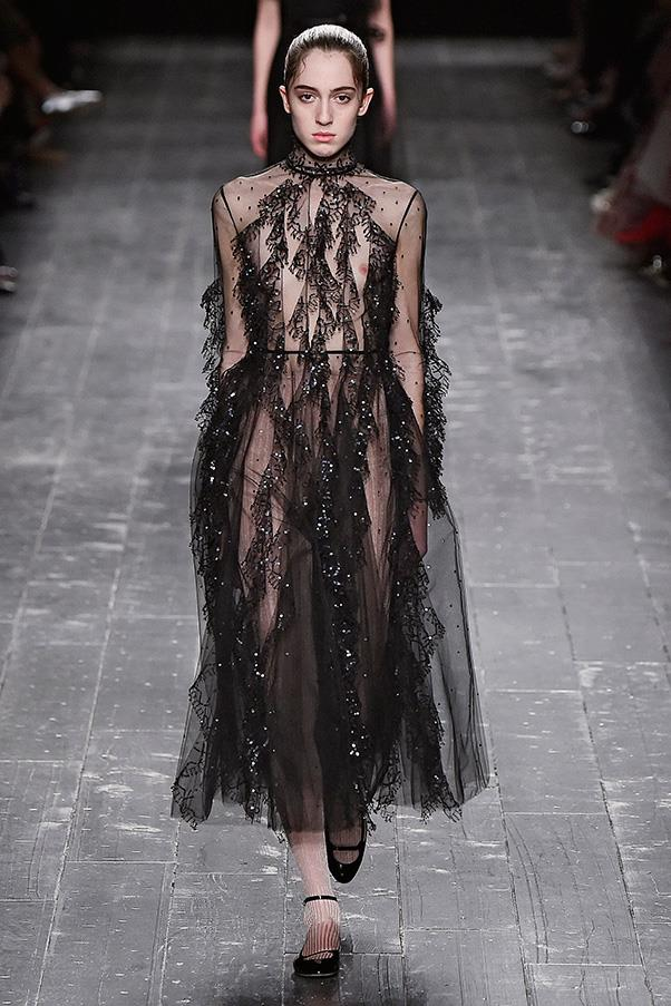 <strong>VALENTINO</strong><BR><BR> Designers Maria Grazia Chiuri & Pierpaolo Piccioli took a risk this season, layering ribbed turtlenecks under spaghetti-strap dresses, pairing a green parka coat with a sequin-bedecked dress, and including plenty of black. Consider this the wardrobe of a ballerina—from show to off-duty looks worn back to her apartment, where city living requires tough boots but an appreciation for all things delicate and glittering.