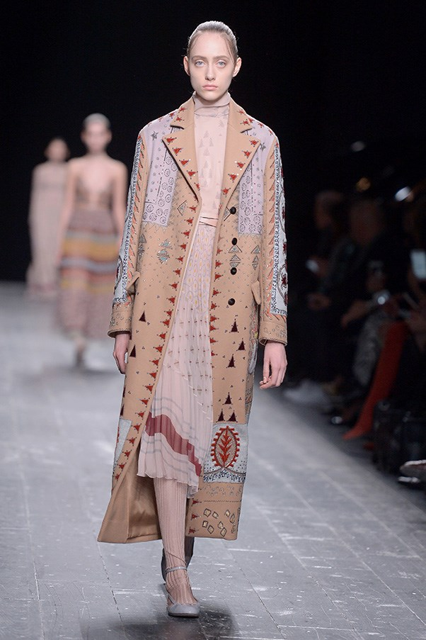 <strong>VALENTINO</strong><BR><BR> An ode to earth and sky seemed to permeate the collection, with tribal prints appearing on earth toned fabrics amongst furs. Stars also made an appearance on ethereal, whimsical, tulle dresses that could as easily appear on stage. - <em>Tara Lamont-Djite</em>