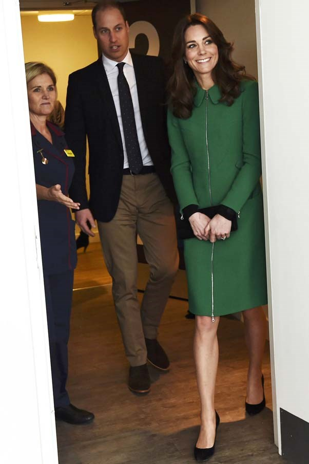 The Duchess looked stylish in a bottle green coat and black accessories during her visit to St Thomas' Hospital in London.