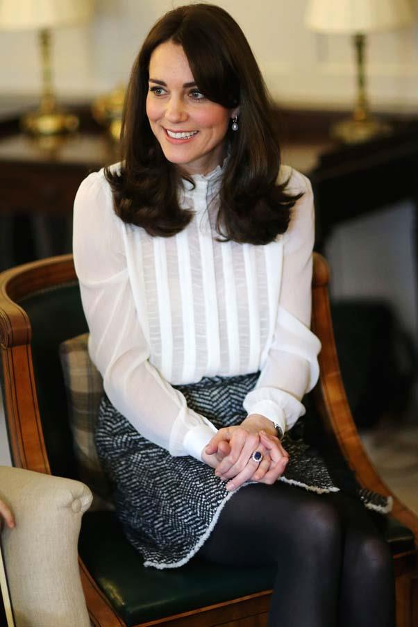 The Duchess looked chic in a polished work outfit consisting of a black tweed skirt and white blouse as Guest Editor of The Huffington Post.