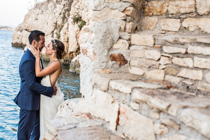 <strong>On the proposal:</strong> <br><br> We had just arrived on the island of Kastellorizo, a couple of days before my sister's wedding. <br><br> I was excited to show Chris around the island. We went for a walk after dinner with family and friends. After a run in with the island's resident bull, we found ourselves alone below the ancient ruins of the castle. <br><br> We walked past some whitewashed steps that led down to the water. As we walked down the stairs that led into the water, Chris grabbed my hand, and as I turned I saw he was on one knee. My initial thought was that it was a joke.