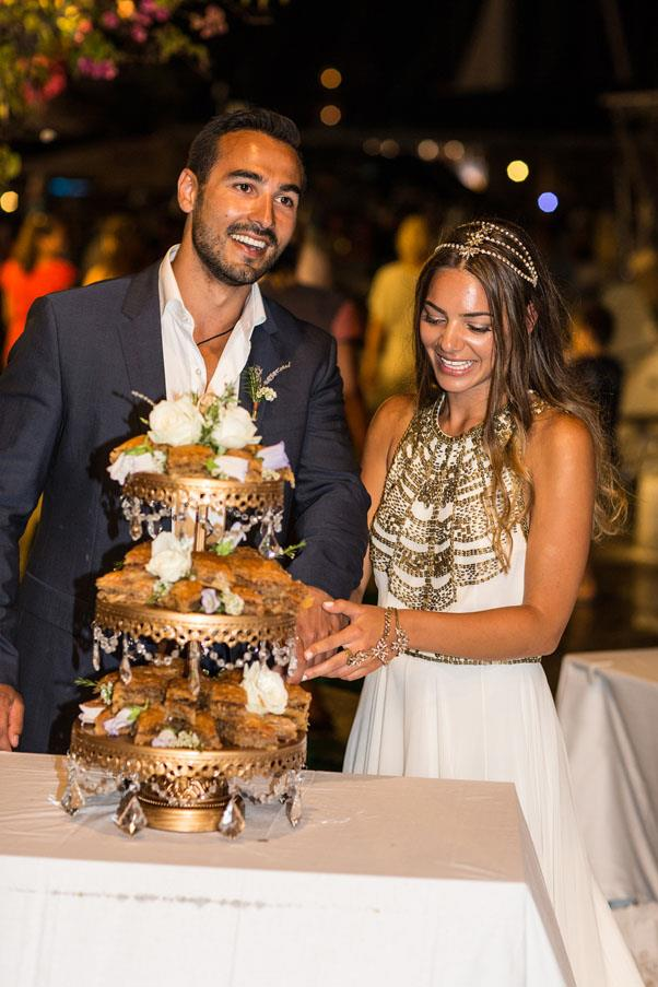 <strong>On the cake:</strong> <br><br> A traditional wedding cake was very difficult to find so we decided on something a little more rustic. We decided on baklava decorated with flowers on an antique gold three-tier stand.