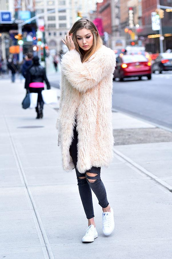 Hadid stepped out in New York in an oversized light pink fur coat and skinny jeans.