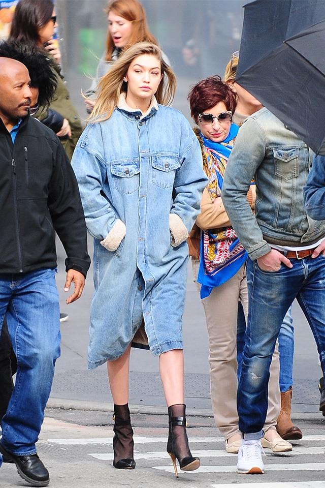 Gigi spotted in New York donning oversized denim and sheer boots.
