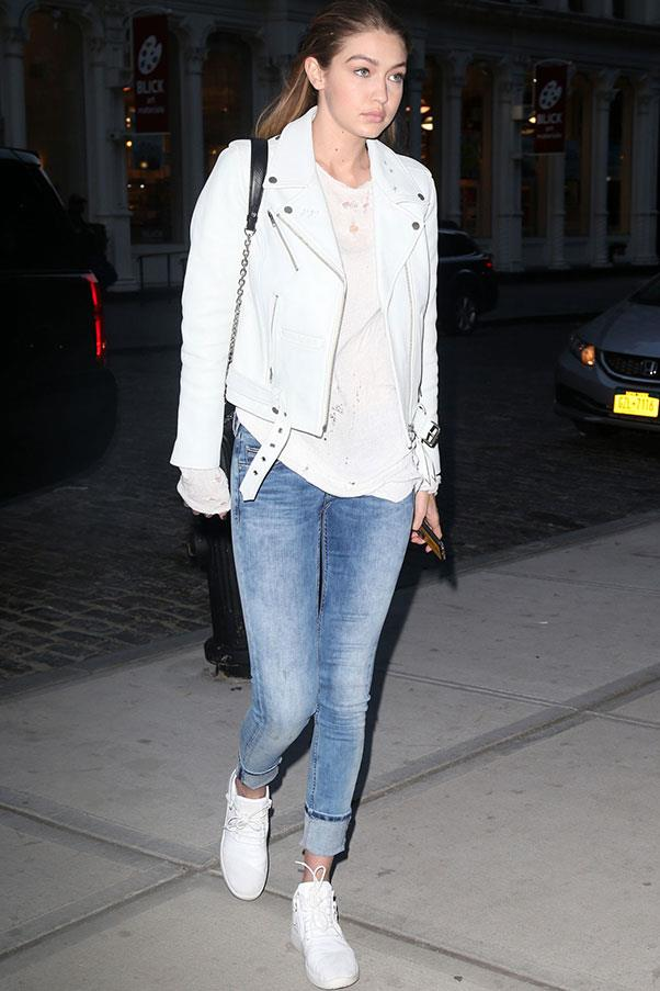 In a cool spring look, Hadid paired a custom white Neuw leather jacket with denim jeans and her signature white sneakers.