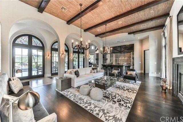 An open, light-filled living room.