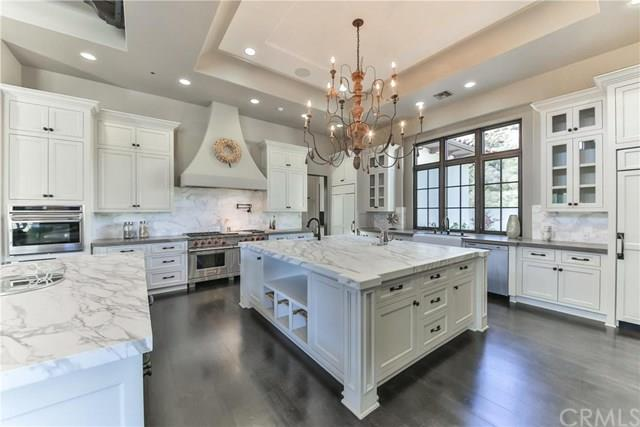The amazing kitchen is a home chef's fantasy with its top-line appliances, white cabinetry and sleek marble countertops.