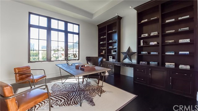 One of two offices, this one features espresso wood tones for a rugged, masculine vibe.