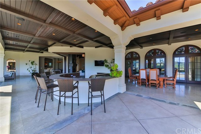 """It's complete with an outdoor bar counter and grill, plus a dining table for more """"formal"""" get-togethers."""
