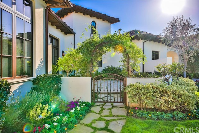 A quaint foliage-covered arbour and gate only adds to the idyllic scene.