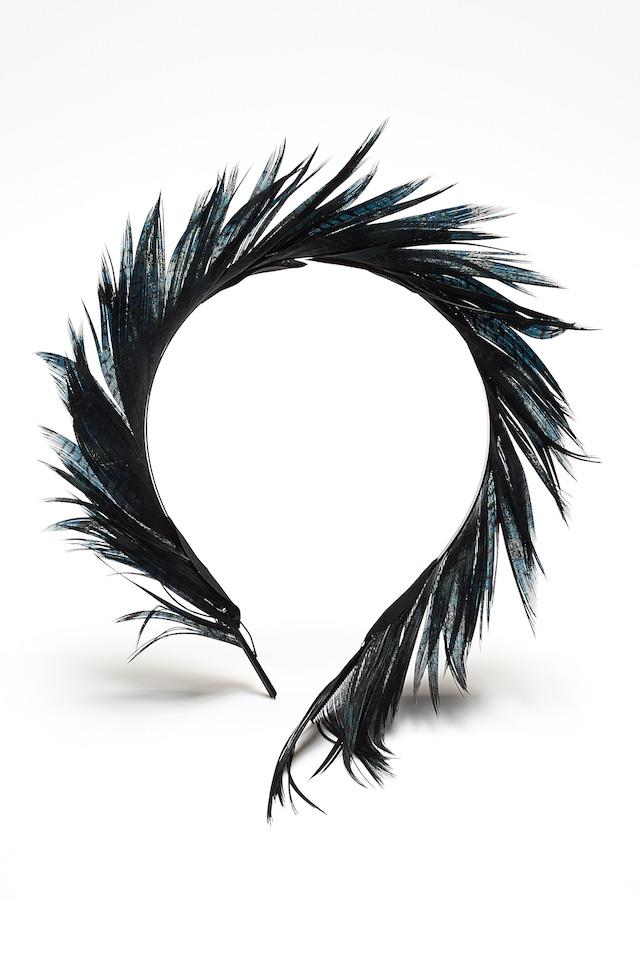 """<strong>Feathers:</strong> <br><br> Feathers have an uncanny way of working for both spring and autumn seasons at the track. Win! just be sure to opt for darker colours and sculptural shapes to keep your look suitably understated. This is no Easter parade. <br><br> Headband, $220, <a href=""""https://www.neridawinter.com/product/ladyhawk-4/"""">Nerida Winter</a>"""