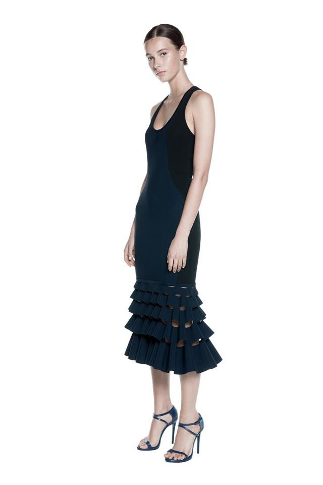 """<strong>Pair with:</strong> <br><br> Go with the sculptural theme and pick a mid-lenth dress or skirt with an eye-catching shape around the hem. Twirl with abandon. <br><br> Dress, $1,590, <a href=""""https://www.dionlee.com/shop/dion-lee/new-arrivals/slash-ruffle-dress-a9187-s16/269136"""">Dion Lee</a>"""