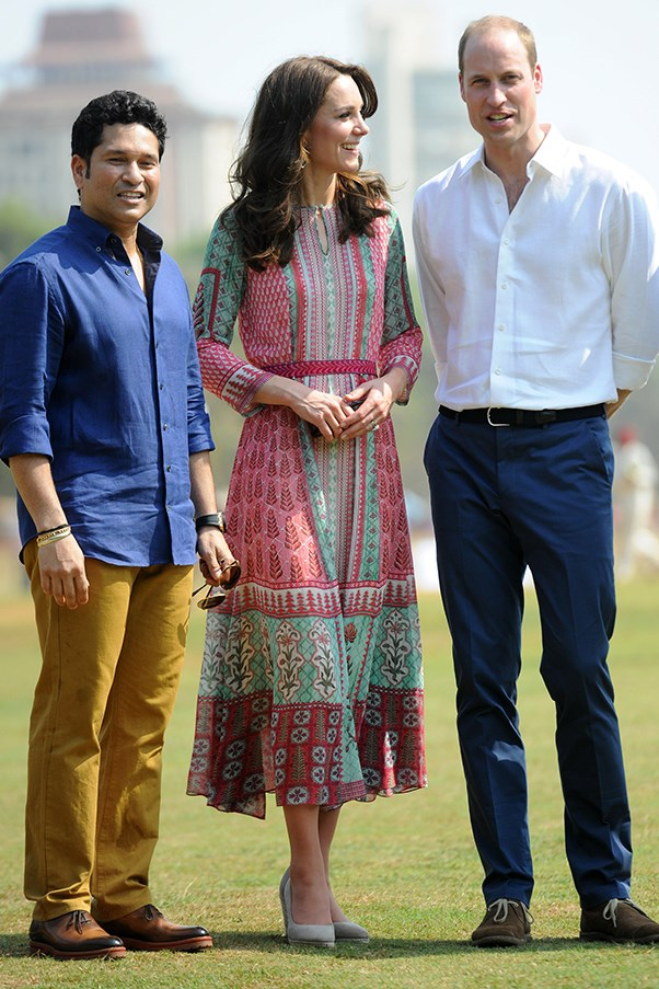 Kate wore a dress by celebrated Indian designer Anita Dongre and Monsoon wedges to play soccer and cricket with local children.
