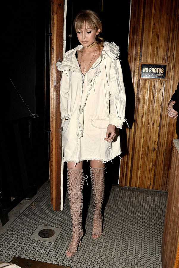Hadid changed into her signature shade of off-white, wearing an anorak coat as a dress, paired with thigh-high lace ups for the MTV Movie Awards after party.
