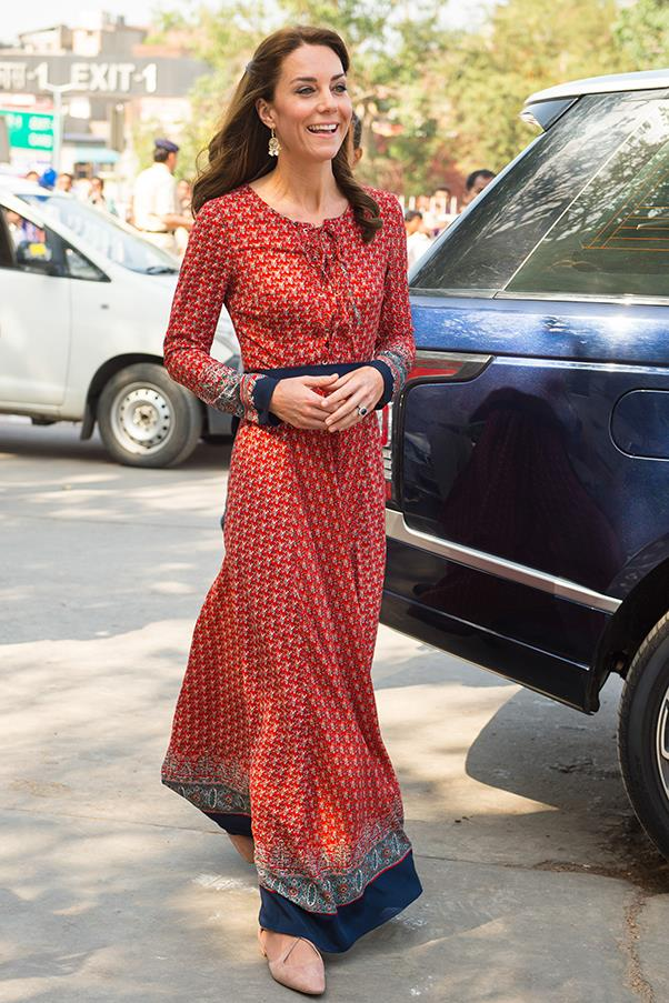 Date wore a lace-up printed maxi and nude suede flats to visit a local charity in Delhi.