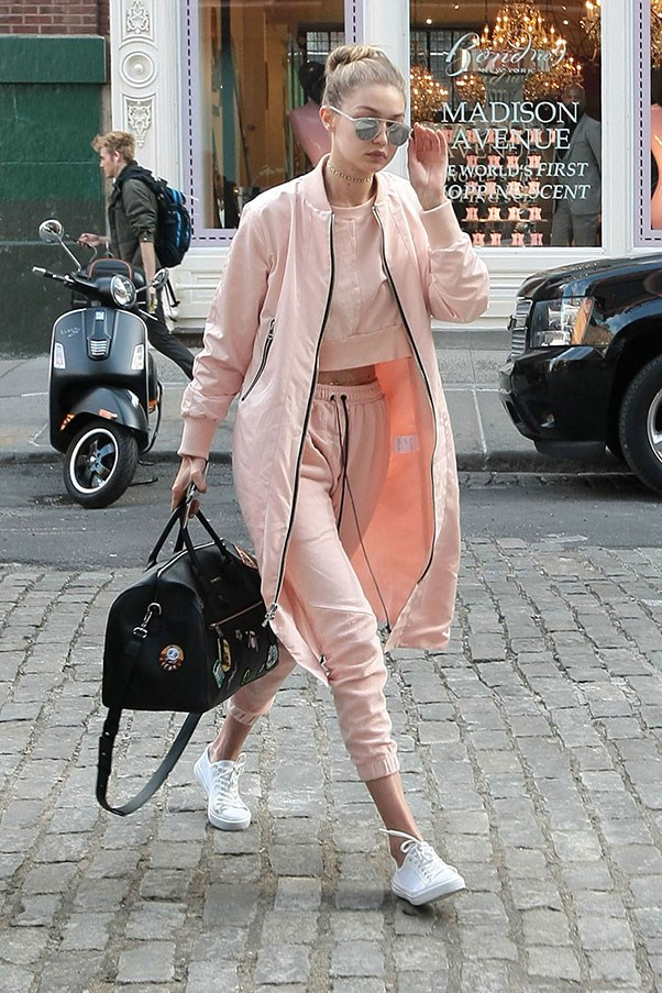 Hadid looked spring ready as she stepped out in pink athleisure separates and metallic aviators.
