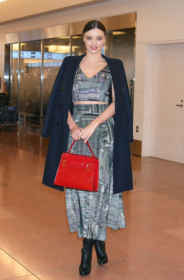 <strong>December 11, 2015</strong><br><br> A ladylike two-piece gets a pop colour colour via a red bag.