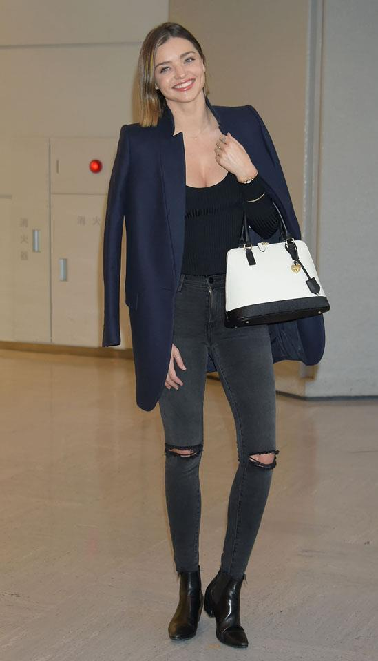 <strong>March 15, 2016</strong><br><br> Back to her off-duty best, on arrival in Tokyo.