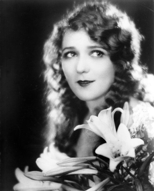 <strong>1925: BRUSHED OUT WAVES</strong> <br><br> As soft and ethereal as the early films this style was worn for, brushed out waves gave actresses like Mary Pickford a feminine silhouette.