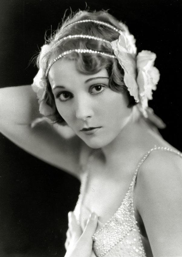 """<strong>1926: BROWBAND</strong> <br><br> A thin, sometimes jeweled piece of fabric worn around the forehead, this style was dubbed the """"headache band"""" — not exactly an appealing accessory nickname, but it looks so chic!"""