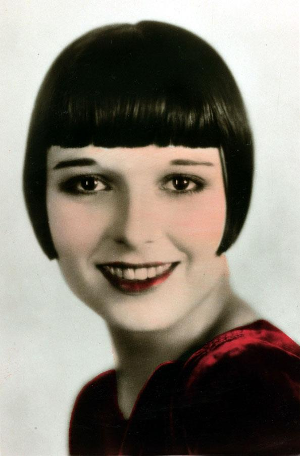 <strong>1927: BLUNT BANGS</strong> <br><br> The total opposite of the era's fluffier looks, blunt bangs framed the face (and thin '20s brows) in the most literal way possible.