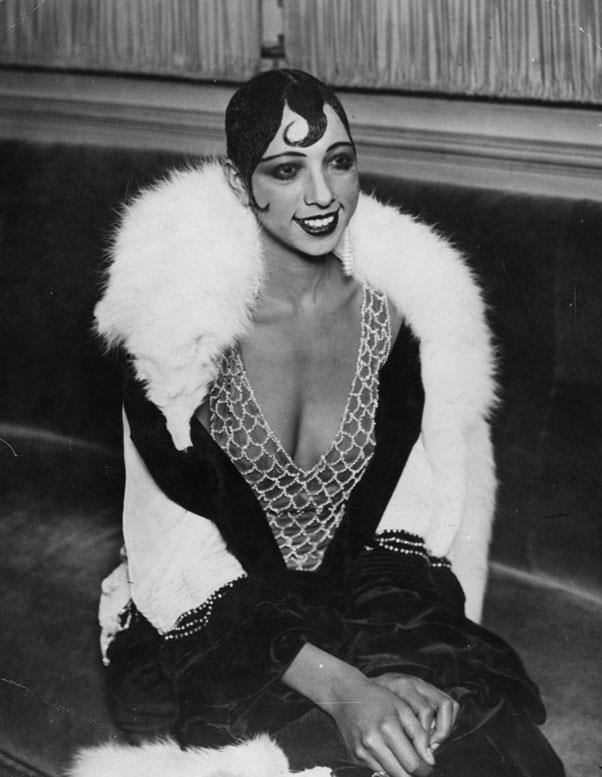 """<strong>1929: ETON CROP</strong> <br><br> One of the most famous wearers of the Eton crop, Josephine Baker rocked her stunning slicked-down style with a """"kiss curl,"""" a thin swirl of hair on her forehead intended to add a touch of femininity."""