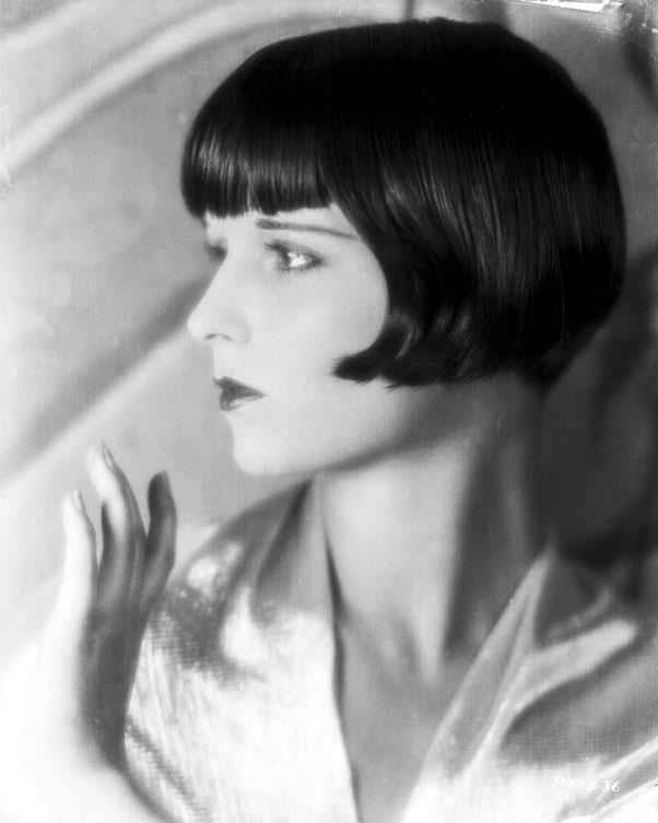 <strong>1931: SHINGLE CUT</strong> <br><br> Here, Louise Brooks shows off her thin eyebrows, bee-stung lips, and chic angular bob cut with swooping ends that was so popular during the '20s and '30s.