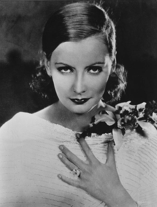 <strong>1932: WAVES PULLED LOW</strong> <br><br> Unlike the looser styles of the decade, many women, including Greta Garbo, preferred to pull their hair tight and low into a dramatic 'do.