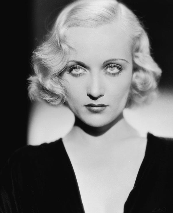 <strong>1933: DEEP SIDE PART</strong> <br><br> A trend that has yet to go out of style, the deep side part was beloved by stars including Carole Lombard as well as millions of women alike.