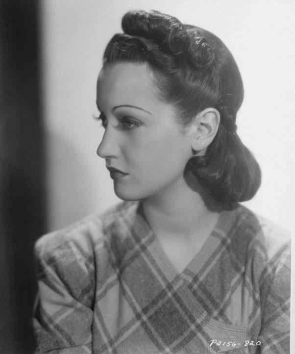 <strong>1937: ROLLED AND TUCKED</strong> <br><br> Dorothy Lamour, among other actresses, touted a less curly style that had hair rolled into a neat silhouette.