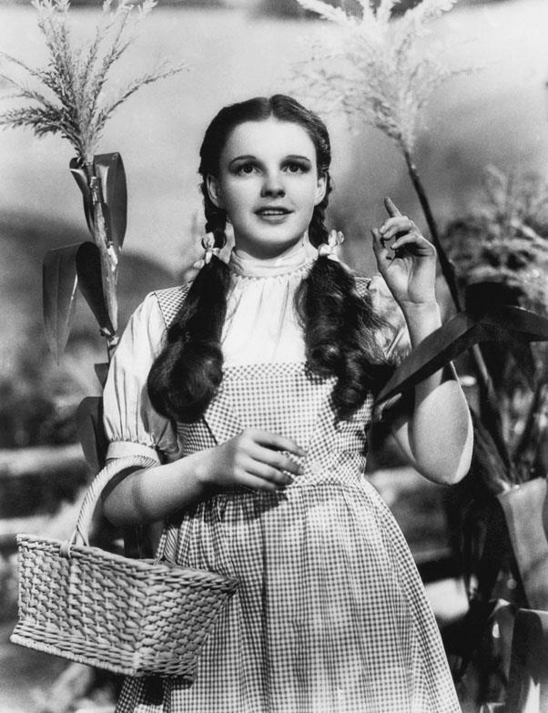 <strong>1939: CURLED PIGTAILS</strong> <br><br> Starring in her most famous role as Dorothy in 1938's wildly popular Wizard of Oz, Judy Garland helped popularize the curly pigtail look.