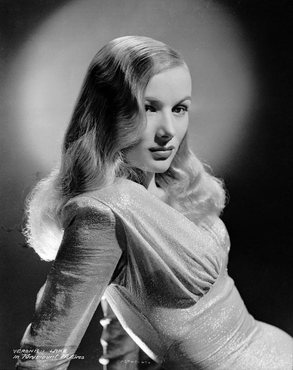 <strong>1943: PEEKABOO BANGS</strong> <br><br> With the femme fatale at the forefront of both fashion and cinema, stars like Veronica Lake ushered in sexy hairstyles that hid just one eye for an air of mystery.