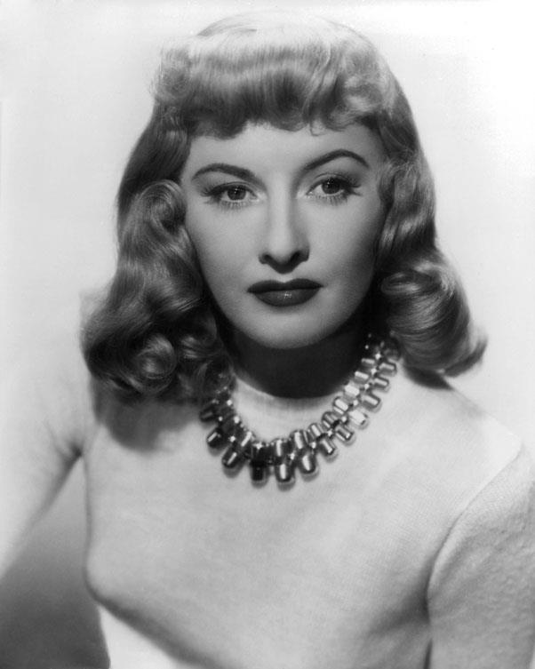 <strong>1944: SOFT WAVES</strong> <br><Br> Delicate curls and waves brought softness to thick bangs and long bobs like Barbara Stanwyck's.