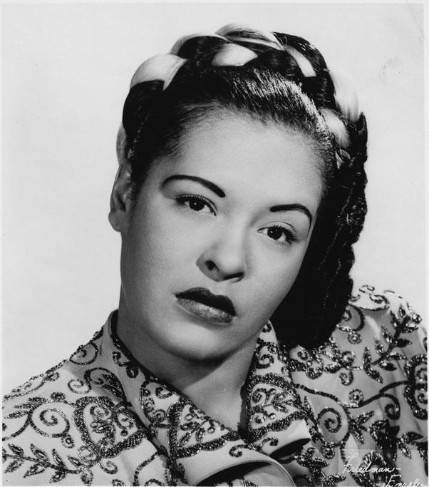<strong>1947: CROWN BRAID</strong> <br><Br> During the '40s, braided hairstyles rose to prominence, with stars like Billie Holiday donning crown braids and braided buns, occasionally weaving in pieces of fabric or hair in contrasting colours.