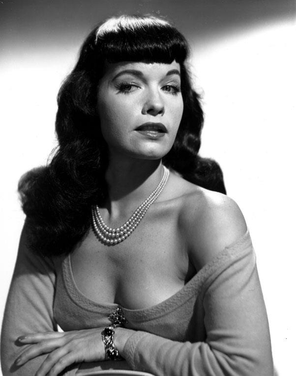 <strong>1951: PINUP BANGS</strong> <br><br> With her sex appeal, outrageous personality, and iconic style, Bettie Page and her famous bangs influenced those who desired an edgier take on traditional looks.