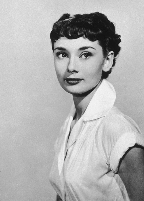 <strong>1953: SHORT CROP</strong> <br><br> Making the short cut more accessible to the masses was Audrey Hepburn, aka America's eternal sweetheart. After chopping her hair in 1953's Roman Holiday, women fell in love with the modern, easygoing style.