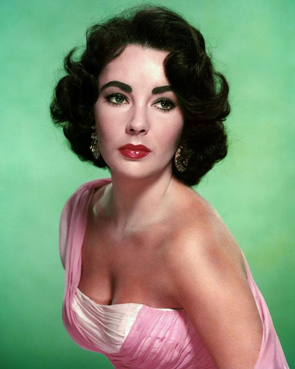 <strong>1957: SOFT FULL CURLS</strong> <br><br> Soft, elegant styles marked the mid-'50s — though all that would soon change.