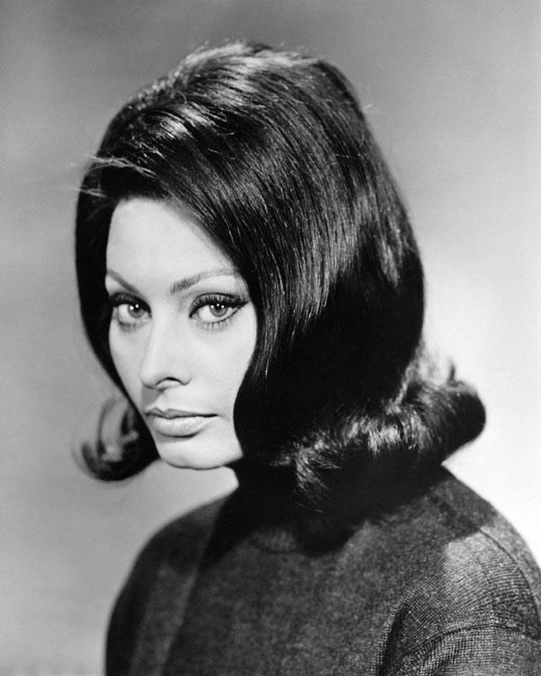 <strong>1959: FLIPPED OUT</strong> <br><br> Bringing a totally new silhouette to the era's style, stars like Sophia Loren popped a cute curl right at the end of the hair.