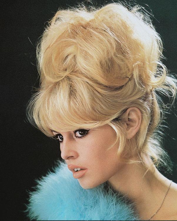 <strong>1960: STACKED UPDO</strong> <br><br> Unlike the neat, polished updos of years prior, women opted for messier, imperfect styles to achieve a sexy look.