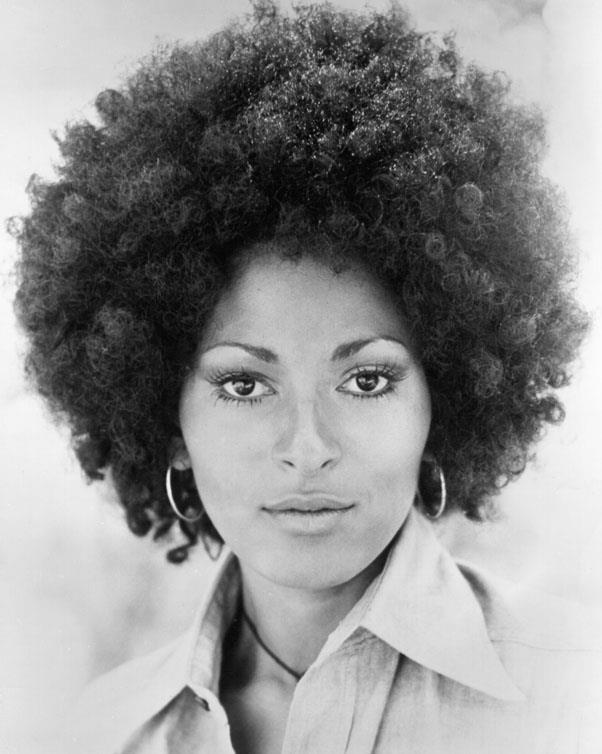 <strong>1972: AFRO</strong> <br><br> As more black women began wearing their hair in natural styles (as opposed to relaxed or covered with a wig), Pam Grier and her voluminous curls became one of the decade's most iconic looks.