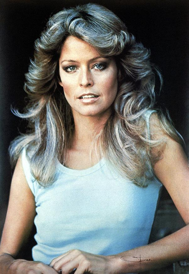 <strong>1978: FARRAH WAVES</strong> <br><br> Farrah Fawcett and her unforgettable hair on Charlie's Angels inspired countless women to highlight their hair and blow it out into full, sweeping waves.